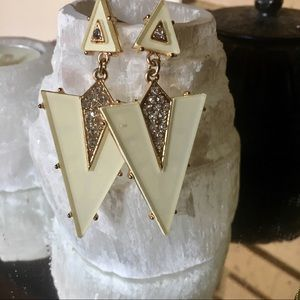 Unique cream and gold dangle earrings.